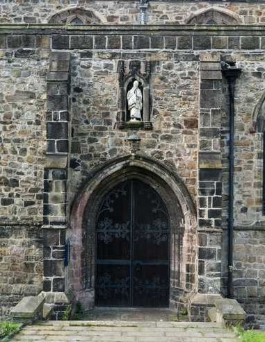 The statute of St.Deiniol above the door of Bangor Cathedral.