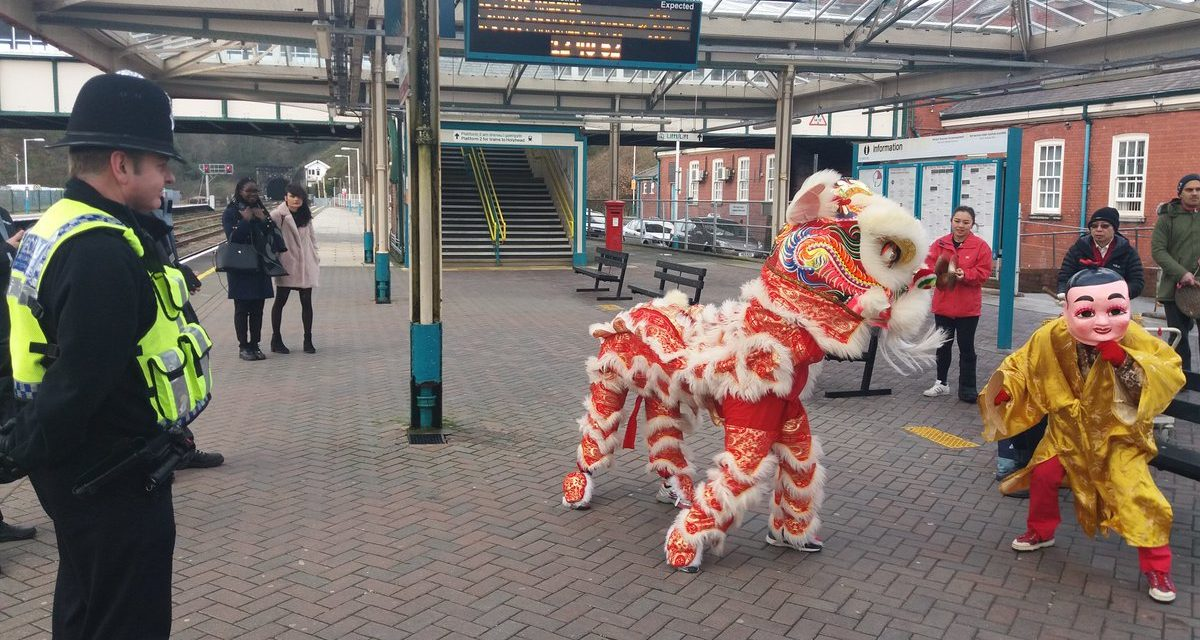 Rail passengers enjoy Chinese dragon dance at Bangor station