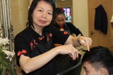 Bangor Hairdresser thanks Coleg Menai for teaching her English
