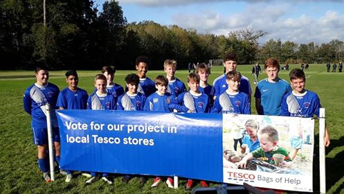 Penrhosgarnedd Juniors receive 'Tesco Bags of Help' cash boost