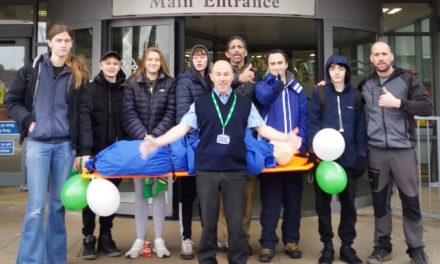 Students carry stretcher from Bangor to Caernarfon for Macmillan Cancer Support