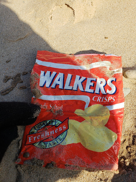 23 year-old crisp packet found at Llanddwyn shows 'plastic is forever'