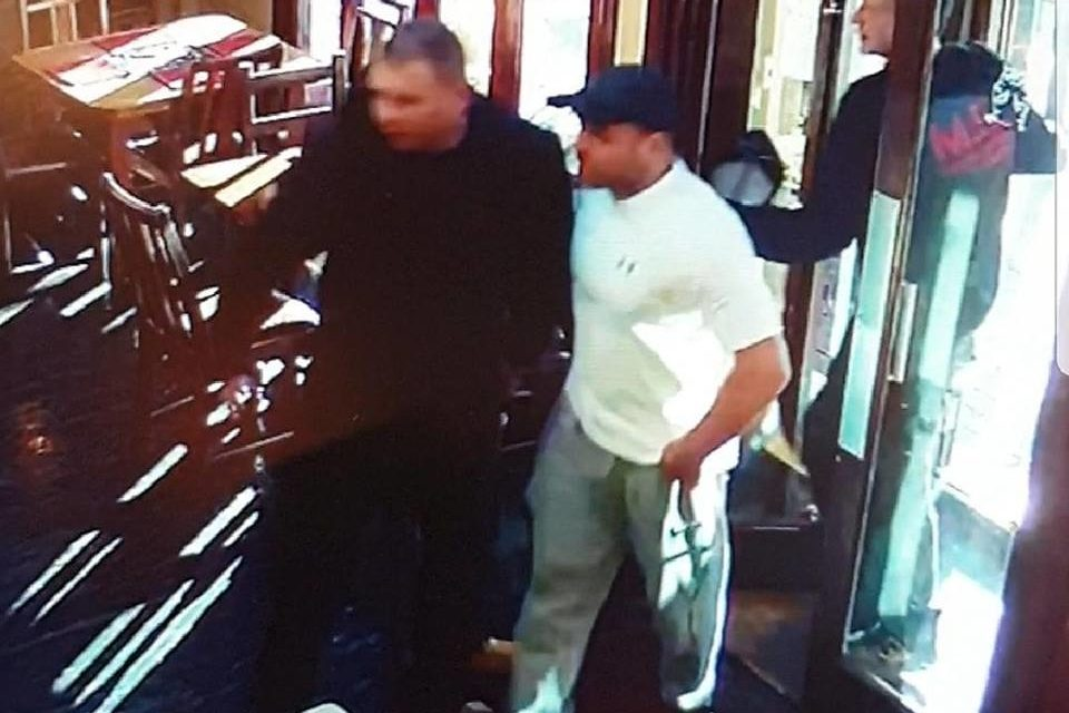 Police appeal to identify men at Wetherspoons in Bangor
