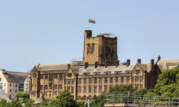 Bangor University flies Pride flag above Main Arts building